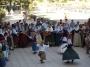 A folk dance act of kids on an Ibiza beach Cala san Vicente.