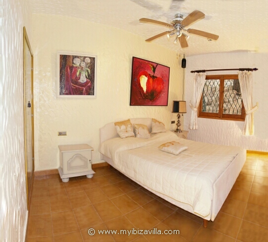 twin bedroom with built-in wardrobes and ventilator of your Spain villa.