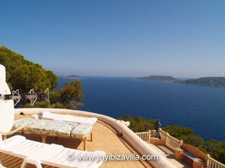 sunbathing on the roof of the villa in Ibiza.